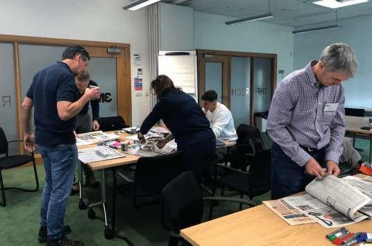 Delegates scanning the daily newspapers and industry magazines for trends, opportunities and market developments